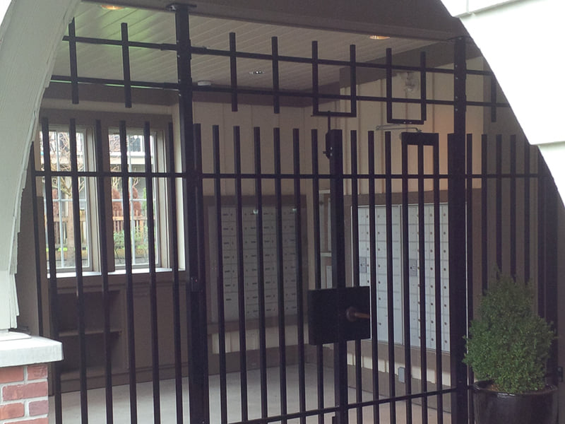 Add security bars to reinforcing mailroom gate